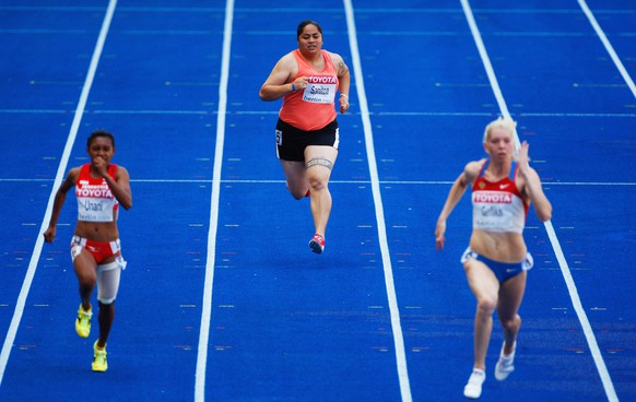 BERLIN - AUGUST 16:  Savannah Sanitoa of American Samoa competes in the women's 100 Metres Heats during day two of the 12th IAAF World Athletics Championships at the Olympic Stadium on August 16, 2009 in Berlin, Germany.  Sanitoa finished the race in 14.23 seconds, outside her PB of 14.07.  (Photo by Stu Forster/Getty Images)
