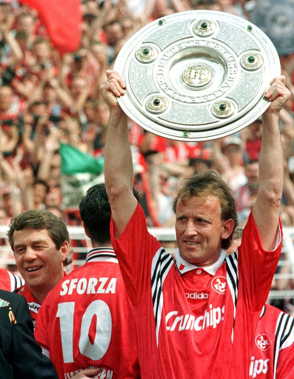 FILE - Andreas Brehme from German soccer champion 1. FC Kaiserslautern displays the trophy in Hamburg's Volkspark Stadium in this May 9, 1998, file picture, while the team's coach Otto Rehhagel, left, looks on. According to German sports informations wire