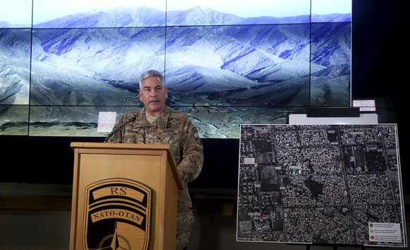 U.S. Army General John Campbell, the commander of international and U.S. forces in Afghanistan, speaks beside a Kunduz city map during a news conference at Resolute Support headquarters in Kabul, Afghanistan, November 25, 2015. The U.S. investigation into a deadly Oct. 3 strike on a hospital run by Medecins Sans Frontieres in the northern Afghan city of Kunduz concluded it was a tragic accident caused primarily by human error, Campbell said on Wednesday. REUTERS/Massoud Hossaini/Pool