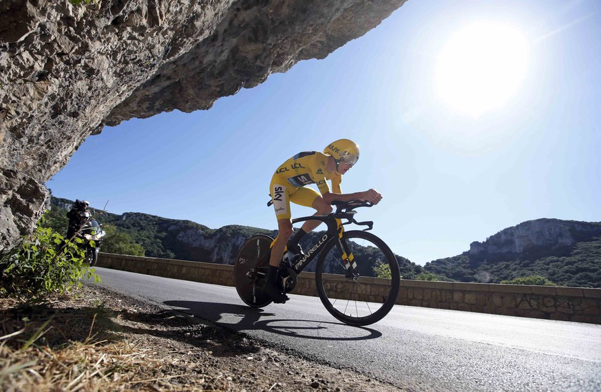 Cycling - Tour de France cycling race - The 37.5 km (23.3 miles) Stage 13 from Bourg-Saint-Andeol to La Caverne du Pont-d'Arc, France - 15/07/2016 - Yellow jersey leader Team Sky rider Chris Froome of Britain rides during the time trial.  REUTERS/Jacques Clawey