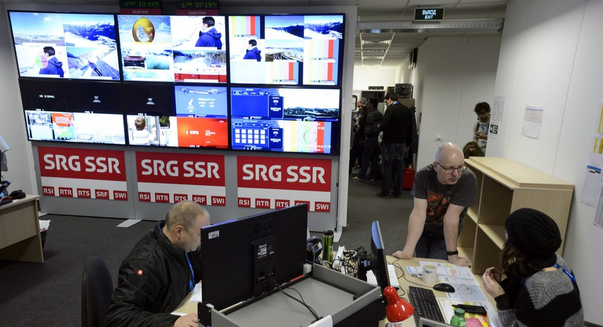Employees of the Swiss National Broadcasting Company SRG SSR work in the Master Control Room during a press visit of the International Broadcasting Center (IBC) at the XXII Winter Olympics 2014 Sochi in Sochi, Russia, on Thursday, February 6, 2014. (KEYSTONE/Laurent Gillieron)