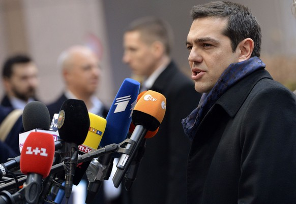 Greek Prime Minister Alexis Tsipras arrives at a European Union leaders summit in Brussels February 12, 2015. Tsipras expressed confidence on Thursday that Athens and fellow euro zone governments would be able to find a mutually acceptable solution for Greece's debt problems.   REUTERS/Stephanie Lecocq/Pool  (BELGIUM - Tags: POLITICS BUSINESS)