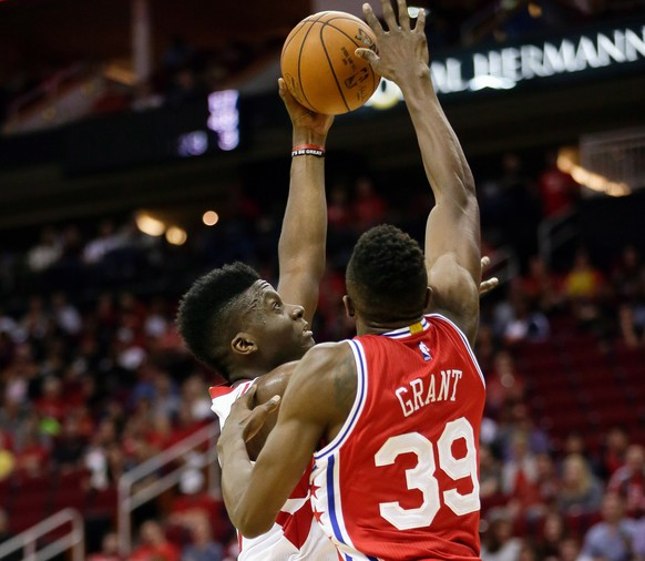 Houston Rockets center Clint Capela, left, drives to the basket on Philadelphia 76ers forward Jerami Grant (39) in the second half of an NBA basketball game Friday, Nov. 27, 2015, in Houston. Houston won 116-114. (AP Photo/Bob Levey)