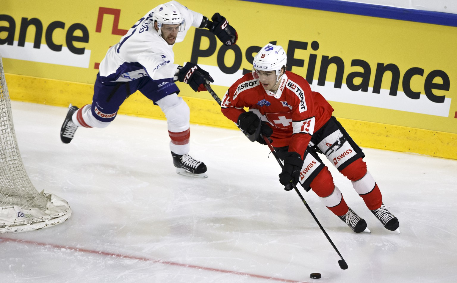 France's forward Anthony Guttig, left, vies for the puck with Switzerland's forward Nico Hischier, right, during a friendly international ice hockey game between Switzerland and France, at the ice stadium De Graben, in Sierre, Switzerland, Friday, April 26, 2019. Switzerland national ice hockey team will play several friendly games of preparation ahead the IIHF 2019 World Championship. (KEYSTONE/Salvatore Di Nolfi)