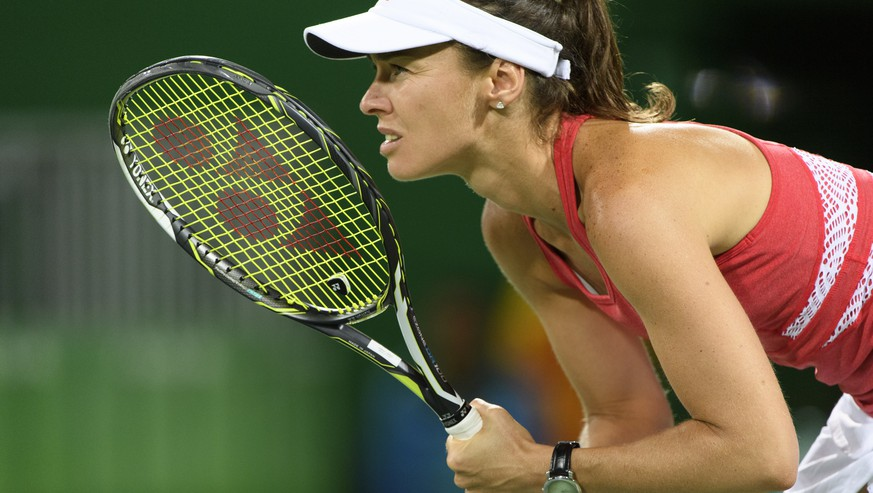 Martina Hingis waits a ball close to teammate Timea Bacsinszky, not pictured, of Switzerland during the women's semi-final doubles match against Andrea Hlavackova and Lucie Hradecka from Czech Republic at the Olympic Tennis Center in Rio de Janeiro, Brazil, at the Rio 2016 Olympic Summer Games, pictured on Friday, August 12, 2016. (KEYSTONE/Laurent Gillieron)
