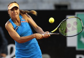 Switzerland's Belinda Bencic returns the ball to Italy's Flavia Pennetta at the Italian open tennis tournament in Rome, Wednesday, May 14, 2014. (AP Photo/Riccardo De Luca)