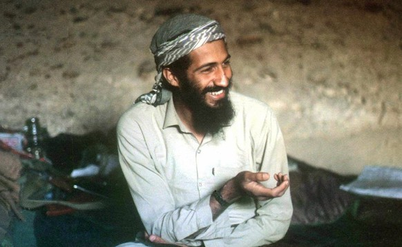 Saudi-born billionaire Osama Bin Laden smiles as he sits in a cave in the Jalalabad region of Afghanistan in this 1988 photo. A CIA-led operation has killed Osama bin Laden in Pakistan and recovered his body after a tortuous decadelong hunt for the elusive militant leader who commanded the terrorist attacks of 11 September 2001. The al-Qaeda leader was killed in a ground operation in a mansion outside Islamabad in an operation, according to U.S. President Obama in a nation address early, 02 May 2011.  EPA/STR