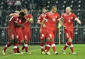 Switzerland's player celebrate after the first scores during the FIFA World Cup 2014 group E qualifying soccer match between Switzerland and Slovenia at the Stade de Suisse stadium in Bern, Switzerland, Tuesday, October 15, 2013. (KEYSTONE/Peter Schneider)