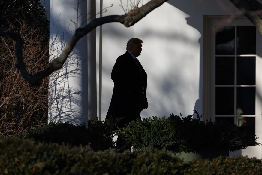President Donald Trump walks to the Oval Office after the National Prayer Breakfast, Thursday, Feb. 8, 2018, in Washington. (AP Photo/Evan Vucci)