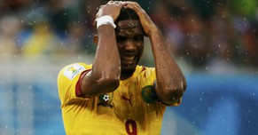 Cameroon's Samuel Eto'o reacts after missing a goal scoring opportunity against Mexico during their 2014 World Cup Group A soccer match at the Dunas arena in Natal June 13, 2014. REUTERS/Jorge Silva (BRAZIL  - Tags: SOCCER SPORT WORLD CUP)