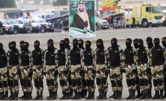 epa05526217 Saudi Arabi's armed forces stand in front of the portrait of Saudi deputy Crown Prince and Defense Minister, Mohammad bin Salman Al Saud, during a military parade ahead of the Muslims holy pilgrimage of Hajj, in Muzdalfa, Saudi Arabia, 05 September 2016. The Haj pilgrimage 2016 takes place in Mecca from 09 to 14  September.  EPA/OMER SALEEM