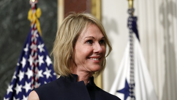 FILE - In this Sept. 26, 2017, file photo, U.S. Ambassador to Canada Kelly Knight Craft stands during her swearing in ceremony in the Indian Treaty Room in the Eisenhower Executive Office Building on the White House grounds in Washington. The Senate has confirmed Craft to become the next U.S. envoy to the United Nations. (AP Photo/Alex Brandon, File) Kelly Knight Craft