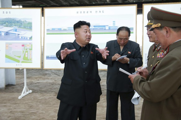 North Korean leader Kim Jong Un gestures during a visit to the construction site of a terminal at Pyongyang International Airport in this undated photo released by North Korea's Korean Central News Agency (KCNA) in Pyongyang on July 11, 2014. REUTERS/KCNA (NORTH KOREA - Tags: POLITICS TRANSPORT BUSINESS CONSTRUCTION) ATTENTION EDITORS – THIS PICTURE WAS PROVIDED BY A THIRD PARTY. REUTERS IS UNABLE TO INDEPENDENTLY VERIFY THE AUTHENTICITY, CONTENT, LOCATION OR DATE OF THIS IMAGE. FOR EDITORIAL USE ONLY. NOT FOR SALE FOR MARKETING OR ADVERTISING CAMPAIGNS. NO THIRD PARTY SALES. NOT FOR USE BY REUTERS THIRD PARTY DISTRIBUTORS. SOUTH KOREA OUT. NO COMMERCIAL OR EDITORIAL SALES IN SOUTH KOREA. THIS PICTURE IS DISTRIBUTED EXACTLY AS RECEIVED BY REUTERS, AS A SERVICE TO CLIENTS