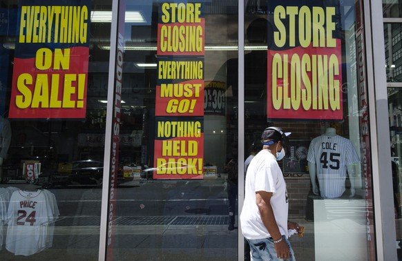 epa08448533 A man walks past a store with closing signs in the window in New York, New York, USA, 27 May 2020. Restrictions requiring the shut down of all non-essential businesses are currently in place around the United States to stop the spread of the highly-contagious coronavirus, though some areas are beginning to be reopen. These restrictions are having massive economic implications and some local and federal politicians are beginning to suggest plans for lifting some rules in an effort to get parts of the economy going again; many health officials are worried this will lead to another spike in COVID-19 cases.  EPA/JUSTIN LANE