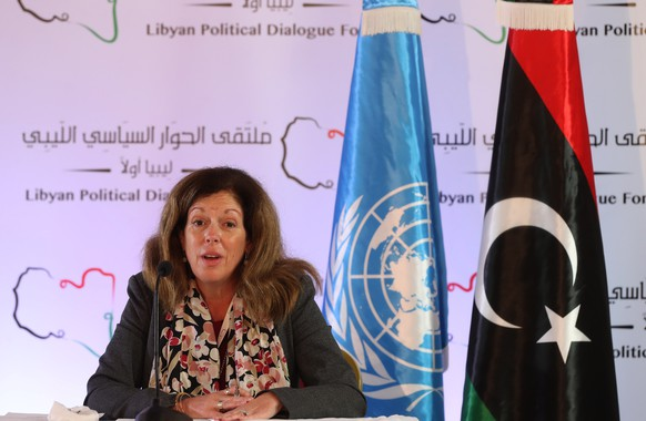 epa08814595 UN acting envoy to Libya Stephanie Williams speaks during a press conference in Tunis, Tunisia on 11 November 2020. Political talks on Libya's future, taking place in Tunisia, have reached a breakthrough, the United Nations acting Libya envoy has said, with agreement on elections within 18 months.  EPA/MOHAMED MESSARA
