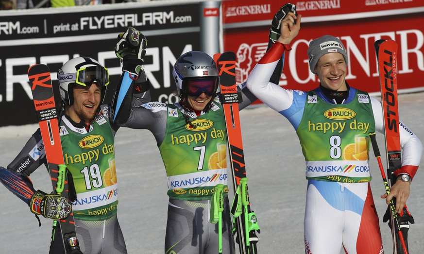 From left, second placed Norway's Rasmus Windingstad, the winner, Norway's Henrik Kristoffersen and third placed Switzerland's Marco Odermatt celebrate in the finish area after an Alpine Skiing World Cup men's Giant Slalom, in Kranjska Gora, Slovenia, Saturday, March. 9, 2019. (AP Photo/Marco Trovati)