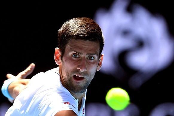 epa05729396 Novak Djokovic of Serbia in action against Denis Istomin of Uzbekistan during their Men's Singles second round match at the Australian Open Grand Slam tennis tournament in Melbourne, Australia, 19 January 2017.  EPA/DEAN LEWINS AUSTRALIA AND NEW ZEALAND OUT