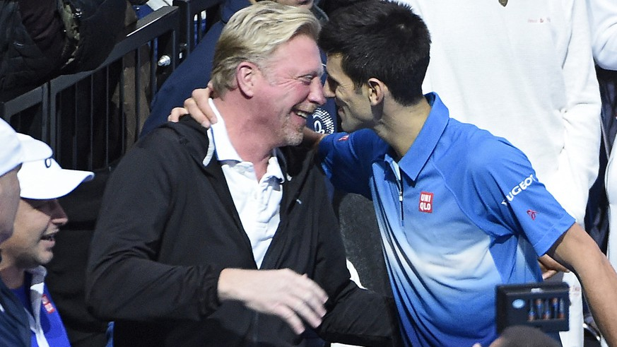 epa05663144 (FILE) A file picture dated 22 November 2015 shows Novak Djokovic of Serbia (R) hugs his coach Boris Becker (L) after winning against Roger Federer of Switzerland during the final at the ATP World Tour Finals in London, Britain. Djokovic on 06 December 2016 confirmed he is parting ways with his coach, German tennis legend Boris Becker.  EPA/FACUNDO ARRIZABALAGA *** Local Caption *** 52401735