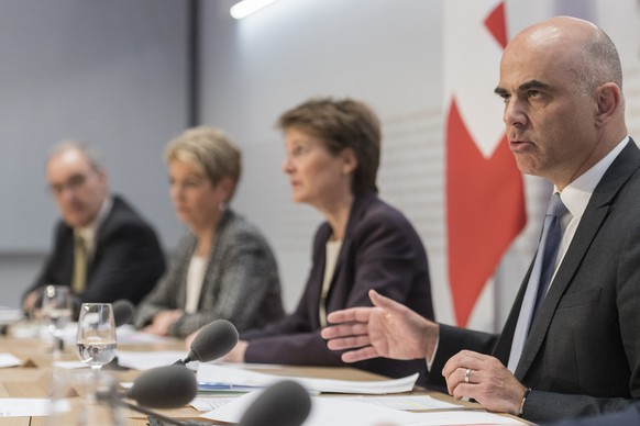 Swiss Federal president Simonetta Sommaruga, 2nd from right, and Federal councillors Alain Berset, Karin Keller-Sutter, and Guy Parmelin, from right, brief the media about the latest measures to fight the Covid-19 Coronavirus pandemic, on Friday, March 13, 2020 in Bern, Switzerland. (KEYSTONE/Alessandro della Valle)