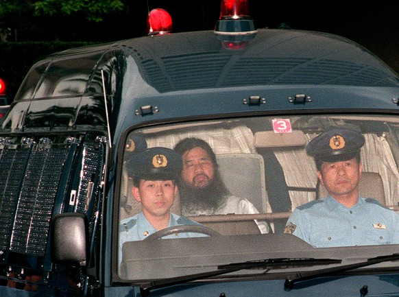 epa06866854 (FILE) - A file photo taken on 16 June 1995 , shows cult Aum Shinrikyo founder Shoko Asahara (C), born Chizuo Matsumoto, being escorted by police to the Tokyo Metropolitan Police Department in Tokyo, Japan (issued 06 July 2018). According to media reports, Matsumoto was executed in Tokyo on 06 July 2018. The doomsday cult leader Matsumoto was convicted for the group's nerve gas attack on Tokyo subway in March 1995, killing 13 people and injuring thousands of people.  EPA/JIJI PRESS JAPAN OUT EDITORIAL USE ONLY  NO ARCHIVES
