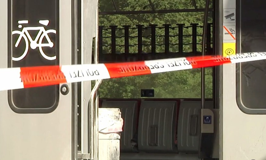 VIDEO GRAB --- A train stands at the trainstation Salez - Sennwald following an attack onboard a train, in Salez, Switzerland, 13 August 2016. According to St. Gallen Canton Police Department, a 27 year old man dispersed flammable liquid on the train and set it alight during an attack. He was also armed with at least one knife. Seven people were  injured in the attack. On Sunday 14 August one women and the suspect were reported death by the police. (KEYSTONE VIDEO/TVO)
