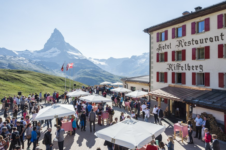 The VIP Apero in front of the Hotel Restaurant Riffelberg with the Matterhorn in the background, prior to the premiere of the theater