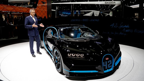 epa06200062 Wolfgang Duerheimer, CEO of Bugatti, presents the new Chiron hypercar at the IAA Car Show in Frankfurt Main, Germany, 12 September 2017. The International Motor Show IAA is the world's largest motor show and automobile exhibition. Exhibitors from up to 40 countries are to present their latest products and innovations at the IAA, while hundreds of thousands of people are expected to visit the show from 14 to 24 September.  EPA/FRIEDEMANN VOGEL
