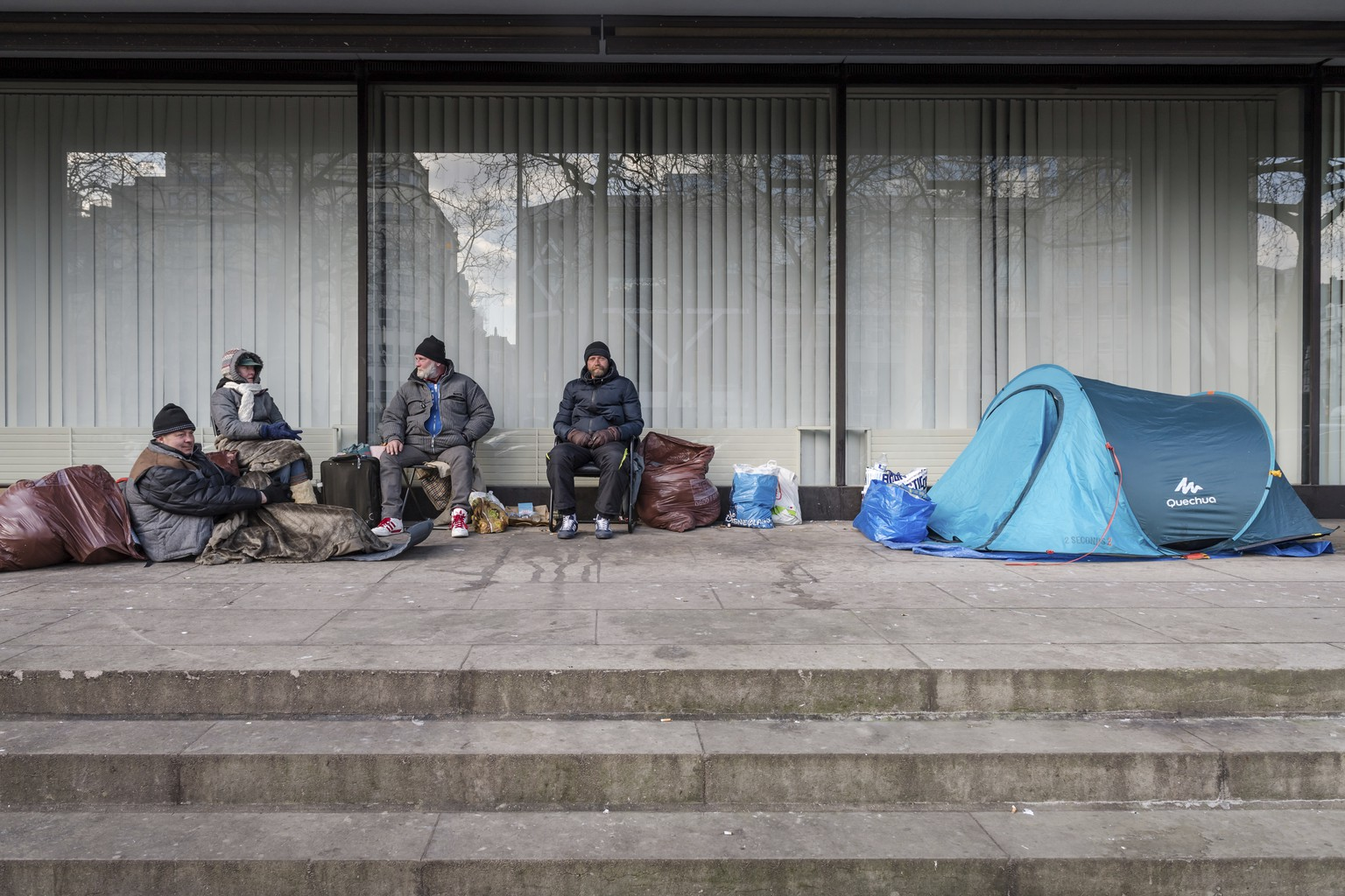 A group of homeless people from Poland, who do not want to go to a shelter, camp under a building in the center of Brussels on Tuesday, Feb. 27, 2018. As a cold snap grips Europe, authorities in Brussels have begun forcing homeless people off the streets and out of sub-zero temperatures. A mayor in the Etterbeek neighborhood has ordered that people be obliged to take shelter at night between 8:00 pm and 7:00 am until March 7 unless the weather improves. (AP Photo/Geert Vanden Wijngaert)
