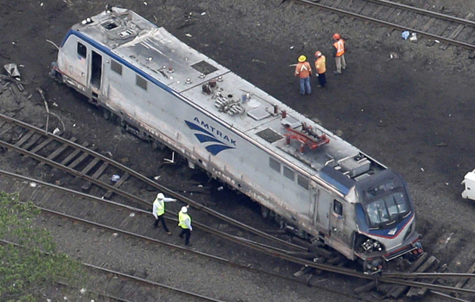 In this May 13, 2015 photo, emergency personnel work at the scene of a deadly train wreck in Philadelphia. (AP Photo/Patrick Semansky)