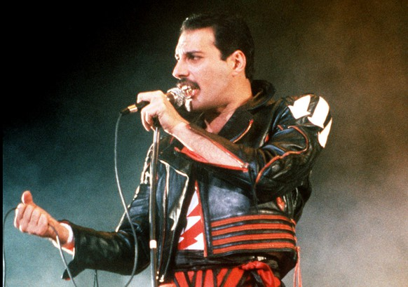 FILE - In this 1985 file photo, singer Freddie Mercury of the rock group Queen, performs at a concert in Sydney, Australia. Queen guitarist Brian May says an asteroid in Jupiter's orbit has been named after the band's late frontman Freddie Mercury on what would have been his 70th birthday, it was reported on Monday, Sept. 5, 2016. May says the International Astronomical Union's Minor Planet Centre has designated an asteroid discovered in 1991, the year of Mercury's death, as