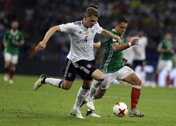 Mexico's Javier Hernandez, right, fights for the ball with Germany's Matthias Ginter during the Confederations Cup, semifinal soccer match between Germany and Mexico, at the Fisht Stadium in Sochi, Russia, Thursday, June 29, 2017. (AP Photo/Thanassis Stavrakis)