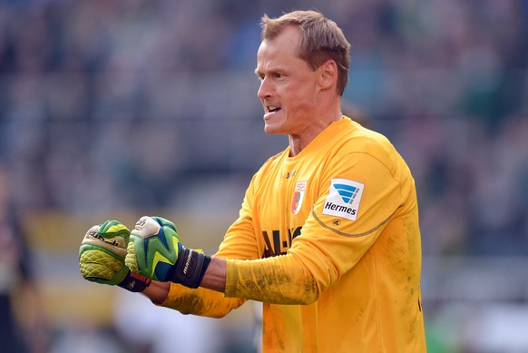 MOENCHENGLADBACH, GERMANY - MARCH 08:  Goalkeeper Alexander Manninger of Augsburg reacts during the Bundesluga match between Borussia Moenchengladbach and FC Augsburg at Borussia-Park on March 8, 2014 in Moenchengladbach, Germany.  (Photo by Lars Baron/Bongarts/Getty Images)