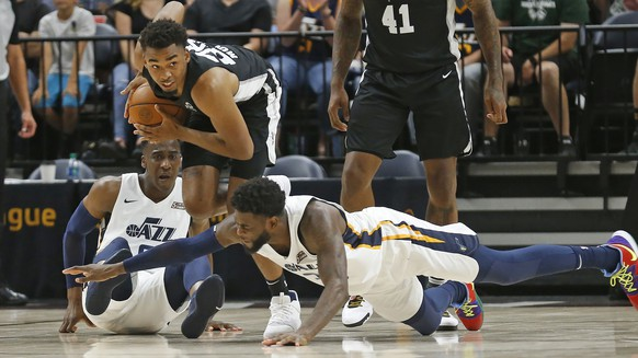 San Antonio Spurs forward Ben Moore, center, recovers a loose ball as Utah Jazz's Willie Reed, foreground, and Miye Oni, rear, defend during the second half of an NBA summer league basketball game Wednesday, July 3, 2019, in Salt Lake City. (AP Photo/Rick Bowmer)Ben Moore,Willie Reed,Miye Oni