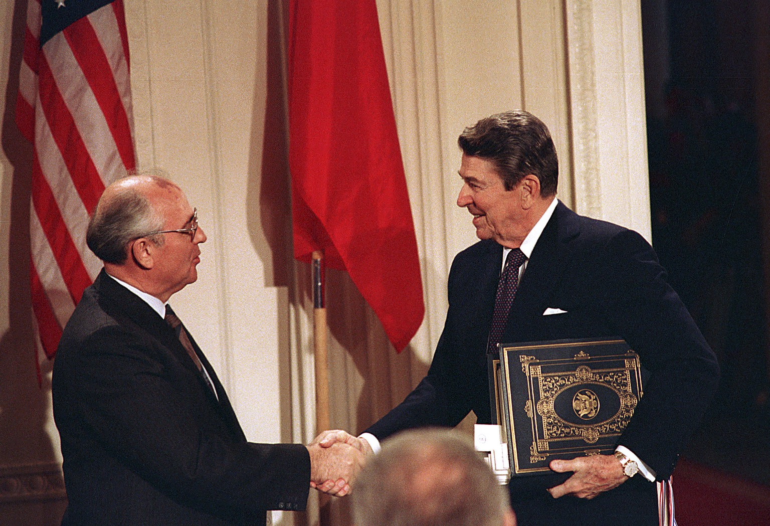 "FILE - Int this Dec. 8, 1997, file photo, U.S. President Ronald Reagan, right, shakes hands with Soviet leader Mikhail Gorbachev after the two leaders signed the Intermediate Range Nuclear Forces Treaty to eliminate intermediate-range missiles during a ceremony in the White House East Room in Washington. In an escalation of tensions, the Obama administration accused Russia on July 28, 2014, of conducting tests in violation of a 1987 nuclear missile treaty, calling the breach ""a very serious matter"" and going public with allegations that have simmered for some time. The treaty confrontation comes at a highly strained time between President Barack Obama and Russian President Vladimir Putin over Russia's intervention in Ukraine and Russia's grant of asylum to National Security Agency leaker Edward Snowden.(AP Photo/Bob Daugherty, File)"