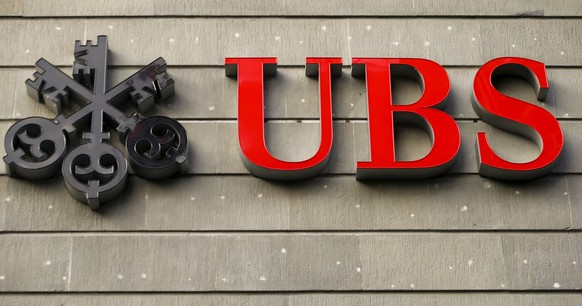 The logo of Swiss bank UBS is seen at an office building in Zurich July 27, 2015. UBS posted on Monday a bigger-than-expected jump in second-quarter net profit as the Swiss bank released results one day early following a newspaper report on the figures. REUTERS/Arnd Wiegmann