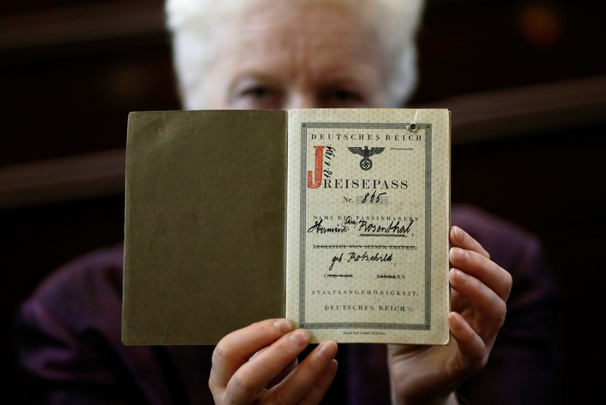 London rabbi Julia Neuberger poses for a photograph with the old German passport of her grandmother, Hermine Sara Rosenthal, at the West London Synagogue in London, Britain September 20, 2016.  REUTERS/Stefan Wermuth