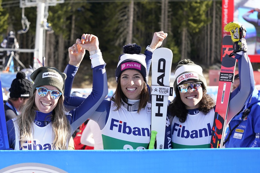 Italy's Elena Curtoni, center, winner of the alpine ski women's World Cup downhill, celebrates with second placed Italy's Marta Bassino, left, and third placed Italy's Federica Brignone, in Bansko, Bulgaria, Saturday, Jan. 25, 2020. (AP Photo/Giovanni Auletta)