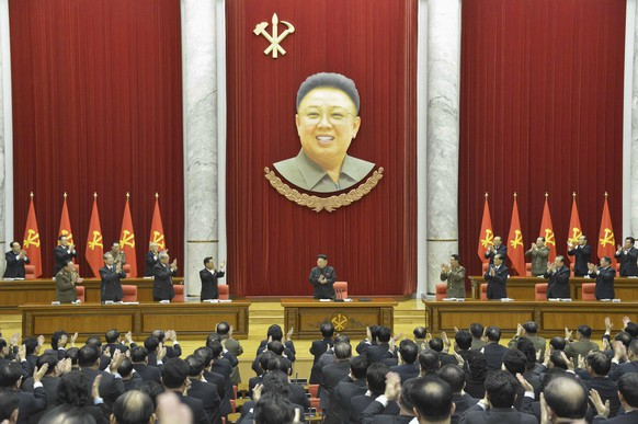 North Korean leader Kim Jong Un (C) supervises an expanded meeting of the Political Bureau of the Central Committee of the Workers' Party of Korea, under a portrait of former North Korean leader Kim Jong Il, in Pyongyang in this February 18, 2015 photo released by North Korea's Korean Central News Agency (KCNA) in Pyongyang February 19, 2015. REUTERS/KCNA (NORTH KOREA - Tags: POLITICS) ATTENTION EDITORS - THIS PICTURE WAS PROVIDED BY A THIRD PARTY. REUTERS IS UNABLE TO INDEPENDENTLY VERIFY THE AUTHENTICITY, CONTENT, LOCATION OR DATE OF THIS IMAGE. FOR EDITORIAL USE ONLY. NOT FOR SALE FOR MARKETING OR ADVERTISING CAMPAIGNS. THIS PICTURE IS DISTRIBUTED EXACTLY AS RECEIVED BY REUTERS, AS A SERVICE TO CLIENTS. NO THIRD PARTY SALES. NOT FOR USE BY REUTERS THIRD PARTY DISTRIBUTORS. SOUTH KOREA OUT. NO COMMERCIAL OR EDITORIAL SALES IN SOUTH KOREA
