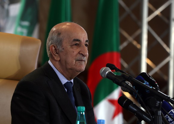 epa08770336 (FILE) - Algerian President-elect Abdelmadjid Tebboune speaks during a press conference in Algiers, Algeria, 13 December 2019 (reissued 24 October 2020). According to a presidency press release, Algerian President Abdelmadjid Tebboune will start a five-day voluntary quarantine as per medical staff of the presidency advice after senior officials showed symptoms of Coronavirus infection.  EPA/MOHAMED MESSARA *** Local Caption *** 55707557