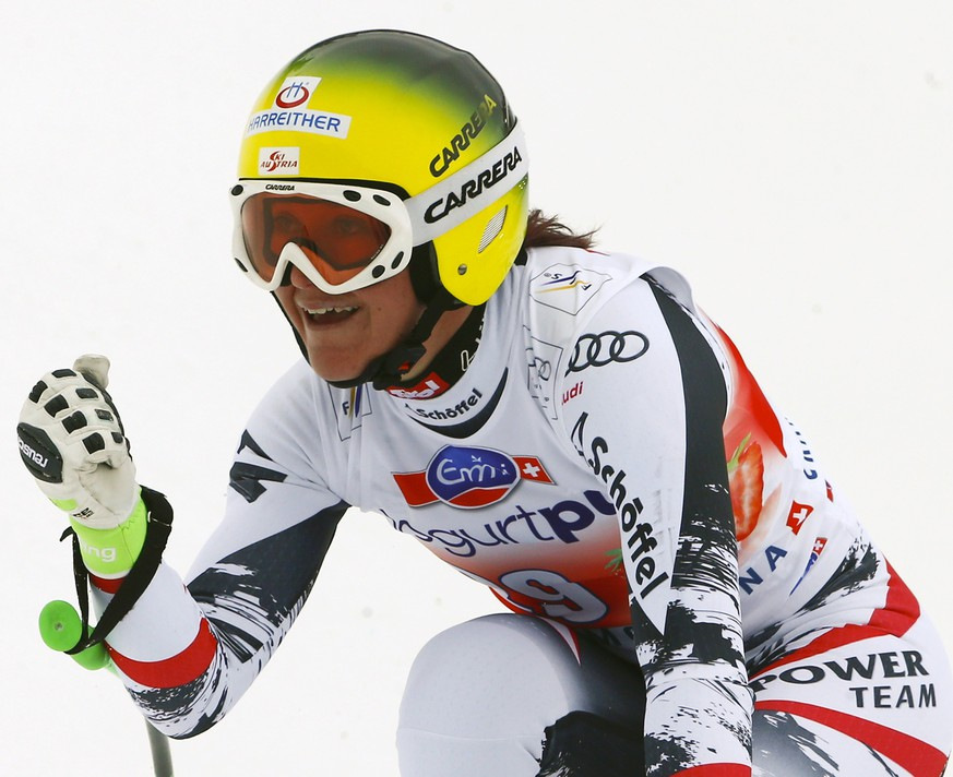 Andrea Fischbacher of Austria reacts following the women's FIS Alpine Skiing World Cup Downhill race in the Swiss resort of Crans Montana March 2, 2014.  REUTERS/Ruben Sprich   (SWITZERLAND - Tags: SPORT SKIING)