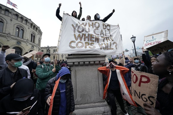 Protesters gather at a demonstration outside the Parliament building in Oslo, Friday, June 5, 2020, over the death of George Floyd, a black man who died after being restrained by Minneapolis police officers on May 25. (Stian Lysberg Solum/NTB Scanpix via AP)