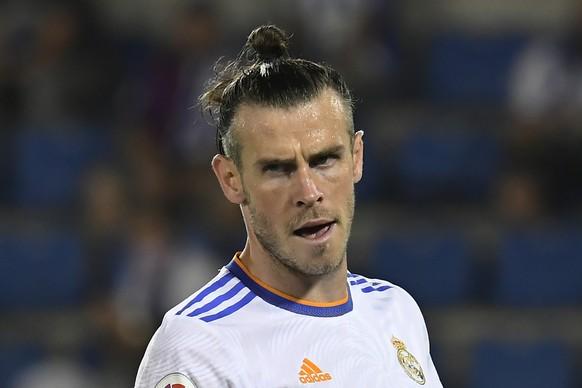Real Madrid's Gareth Bale reacts during a Spanish La Liga soccer match between Alaves and Real Madrid at the Mendizorroza stadium in Vitoria, Spain, Saturday, Aug. 14, 2021. (AP Photo/Alvaro Barrientos)