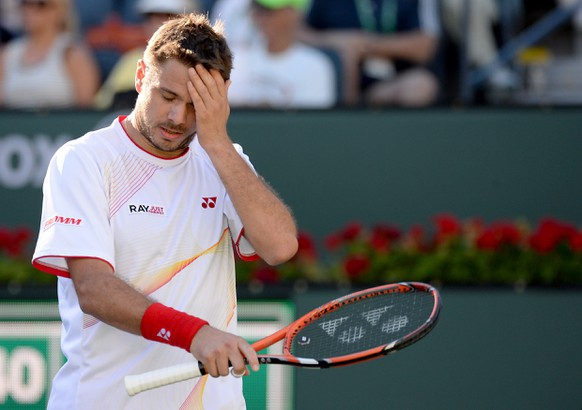 Mar 12, 2014; Indian Wells, CA, USA;  Stanislas Wawrinka (SUI) reacts during his fourth round match against Kevin Anderson (not pictured) during the BNP Paribas Open at the Indian Wells Tennis Garden. Anderson won 7-6, 4-6, 6-1. Mandatory Credit: Jayne Kamin-Oncea-USA TODAY Sports