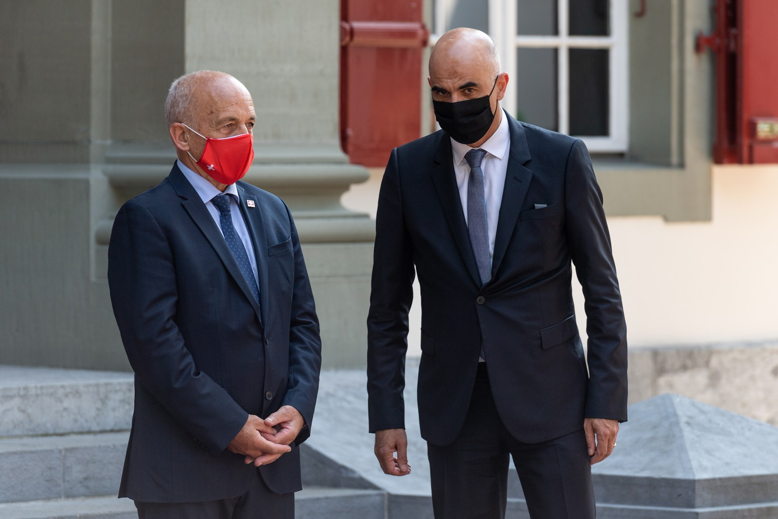 epa08678489 Swiss Federal councillors Ueli Maurer (L) and Alain Berset (R) wait for the arrival of Austrian Chancellor Sebastian Kurz at the Lohn residence of the Swiss government, in Kehrsatz near Bern, Switzerland, 18 September 2020.  EPA/ALESSANDRO DELLA VALLE