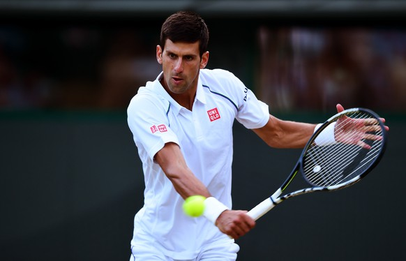 LONDON, ENGLAND - JULY 06:  Novak Djokovic of Serbia plays a backhand in his Gentlemen's Singles Fourth Round match against Kevin Anderson of South Africa during day seven of the Wimbledon Lawn Tennis Championships at the All England Lawn Tennis and Croquet Club on July 6, 2015 in London, England.  (Photo by Shaun Botterill/Getty Images)
