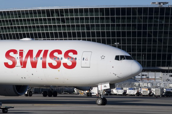 "An aircraft Boeing 777 of Swiss International Air Lines in the front of ""the Circle"" at the Zurich Aeroport, in Zurich, Switzerland, Monday, April 27, 2020.  (KEYSTONE/Ennio Leanza)"