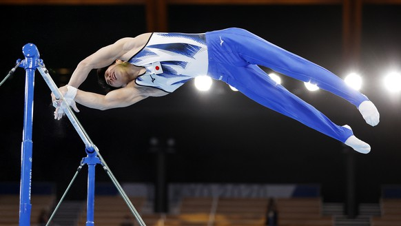 epa09374280 Daiki Hashimoto of Japan competes on the Horizontal Bar in the Men's All-Around Final during the Artistic Gymnastics events of the Tokyo 2020 Olympic Games at the Ariake Gymnastics Centre in Tokyo, Japan, 28 July 2021.  EPA/HOW HWEE YOUNG