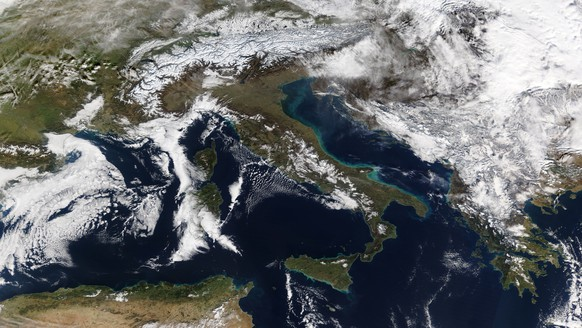 epa07289751 A handout photo made available by NASA of a satellite image showing a partial view of mainland Europe (in picture are seen central, southern and southeastern Europe) affected by winter weather, 16 January 2019. According to weather forecasts, avalanche risks will continue in Austria and southern Germany as Europe is battling its worst snowfall in decades.  EPA/NASA Worldview HANDOUT  HANDOUT EDITORIAL USE ONLY