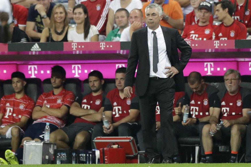 Bayern coach Carlo Ancelotti watches his team during the German Bundesliga soccer match between FC Bayern Munich and SV Werder Bremen at the Allianz Arena stadium in Munich, Germany, Friday, Aug. 26, 2016. (AP Photo/Matthias Schrader)
