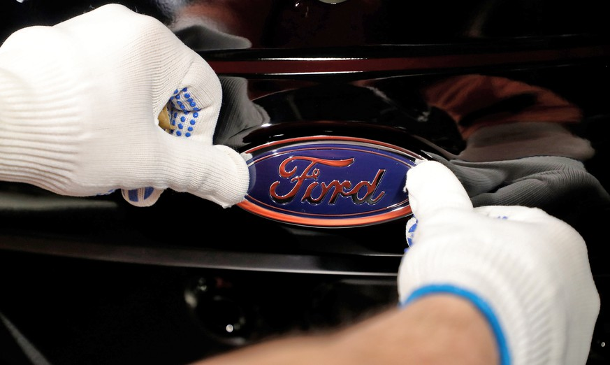 epa07314696 (FILE) - A worker attaches the Ford logo to a Fiesta car at the US car manufacturer plant Ford in Cologne, Germany, 18 January 2019 (reissued 24 January 2019). Ford on 23 January 2019 said their 4th quarter 2018 earnings missed estimates of analysts, with the company being profitable in USA but losing in other markets. Ford reported a loss 116 million USD for the 4th quarter 2018, compared with 2.5 billion USD net profit in 4th quarter 2017 and said it would reduce its workforce in Europe by thousands of employees in a bid to become profitable  again.  EPA/FRIEDEMANN VOGEL